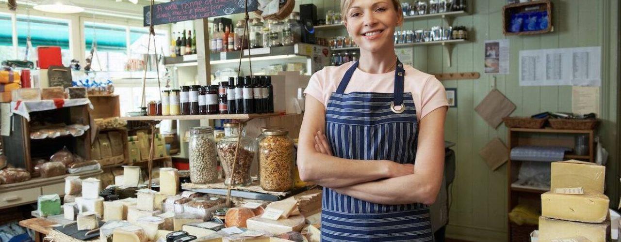 Owner Of Delicatessen Standing In Shop