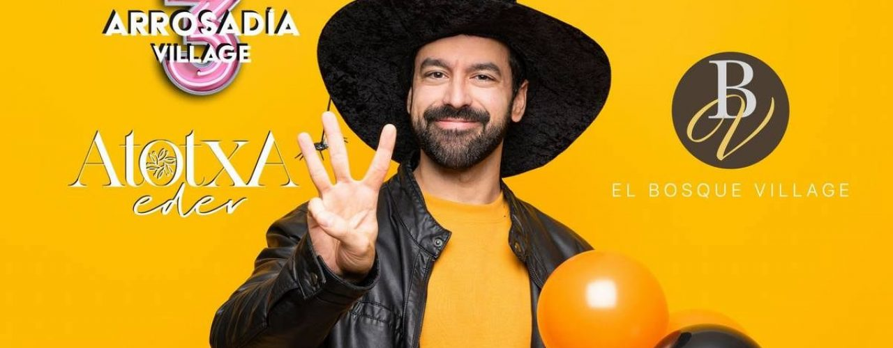 Man with witch hat holding black and orange air balloons for halloween party happy and counting three with fingers